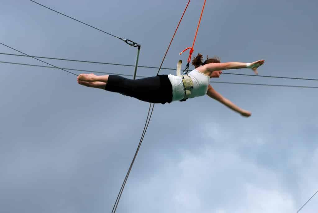photo of a gymnast on a hirewire