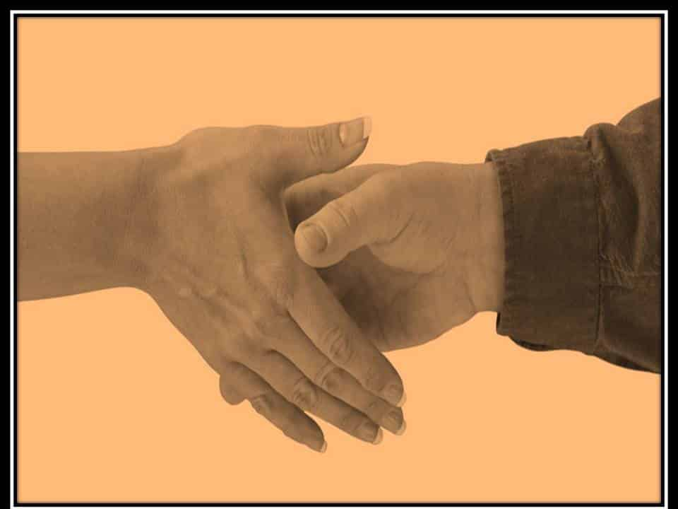 photo of man and woman shaking hands