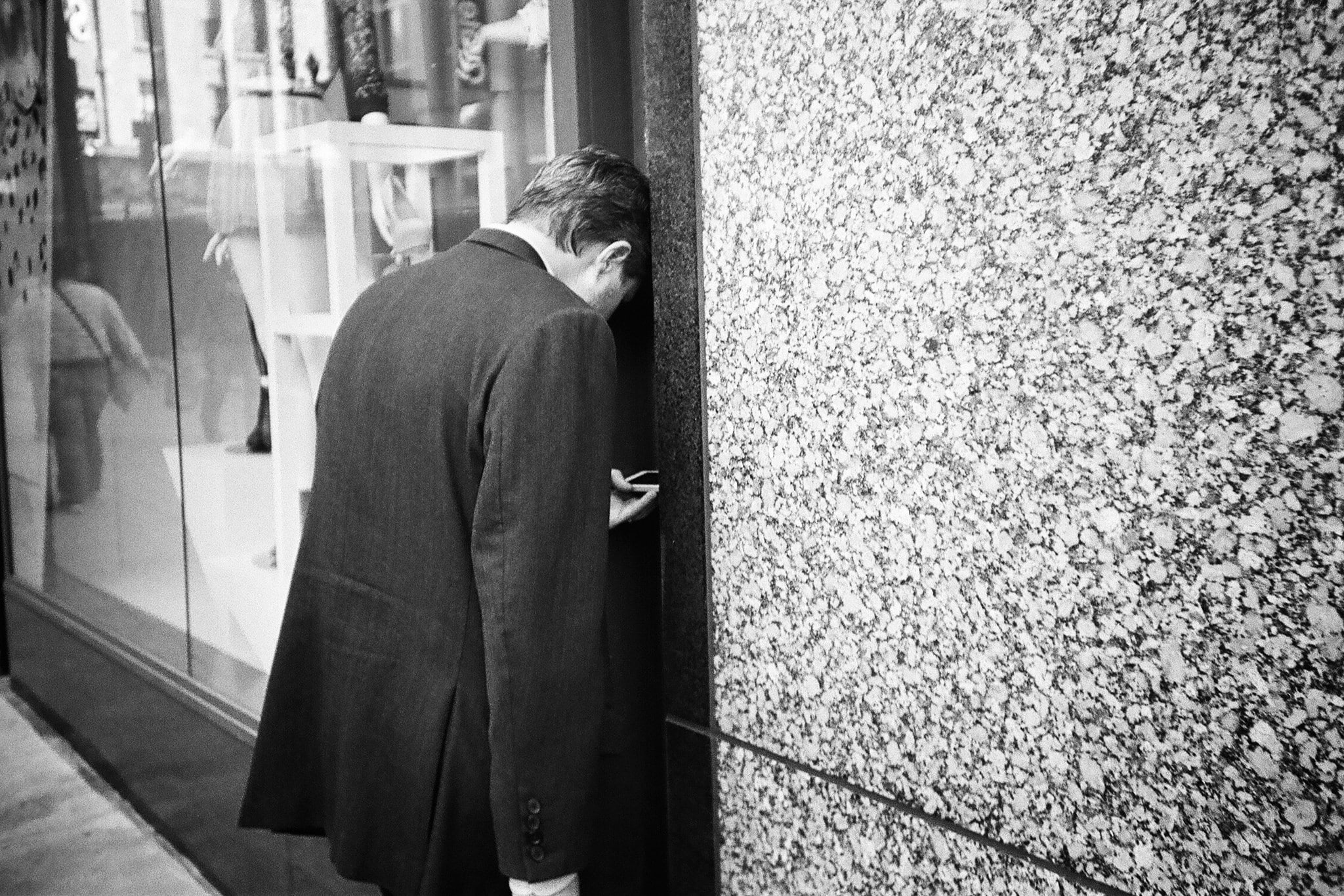 photo of a man facing a wall