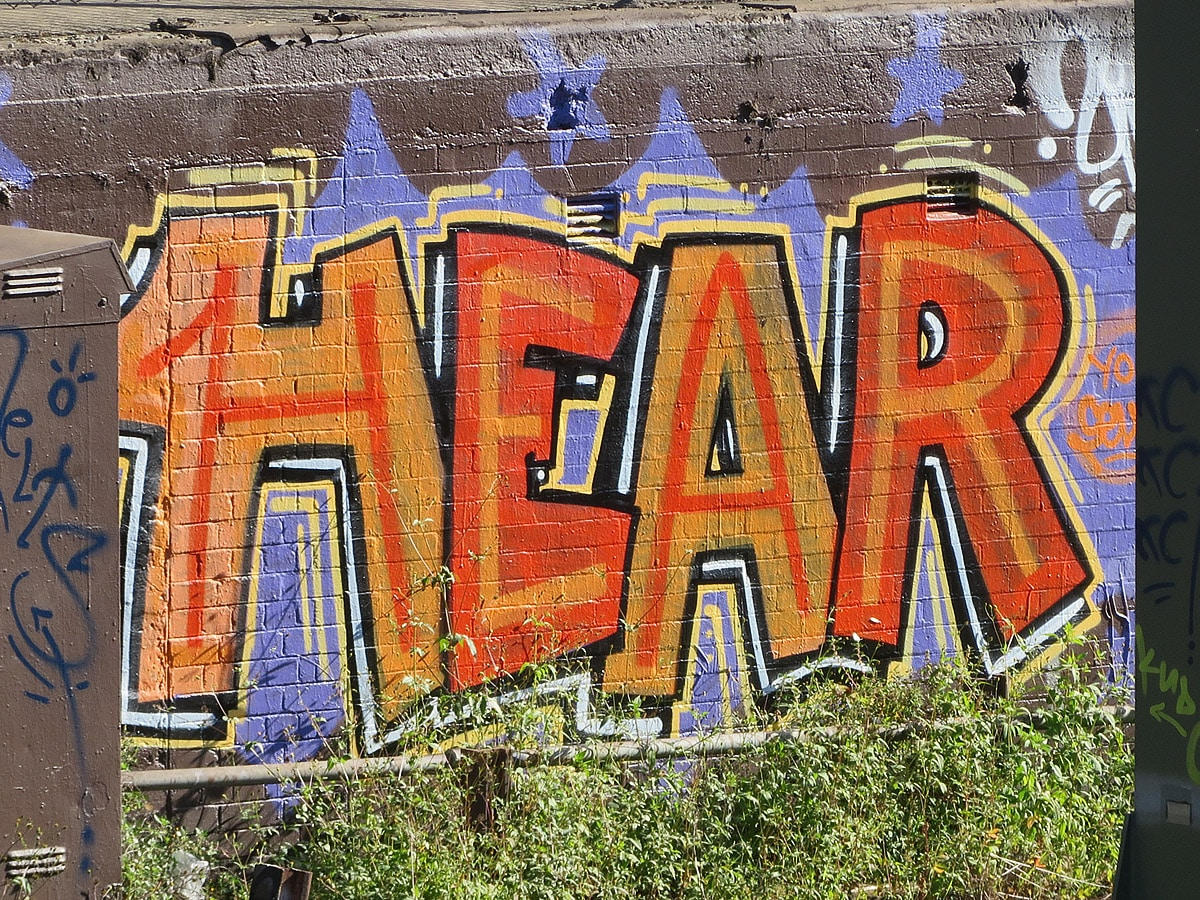 Wall with the word hear painted on it
