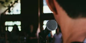 Photo of a man behind a microphone