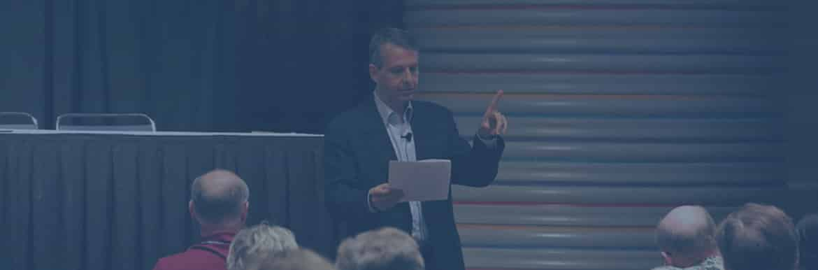 Gideon speaking at a conference