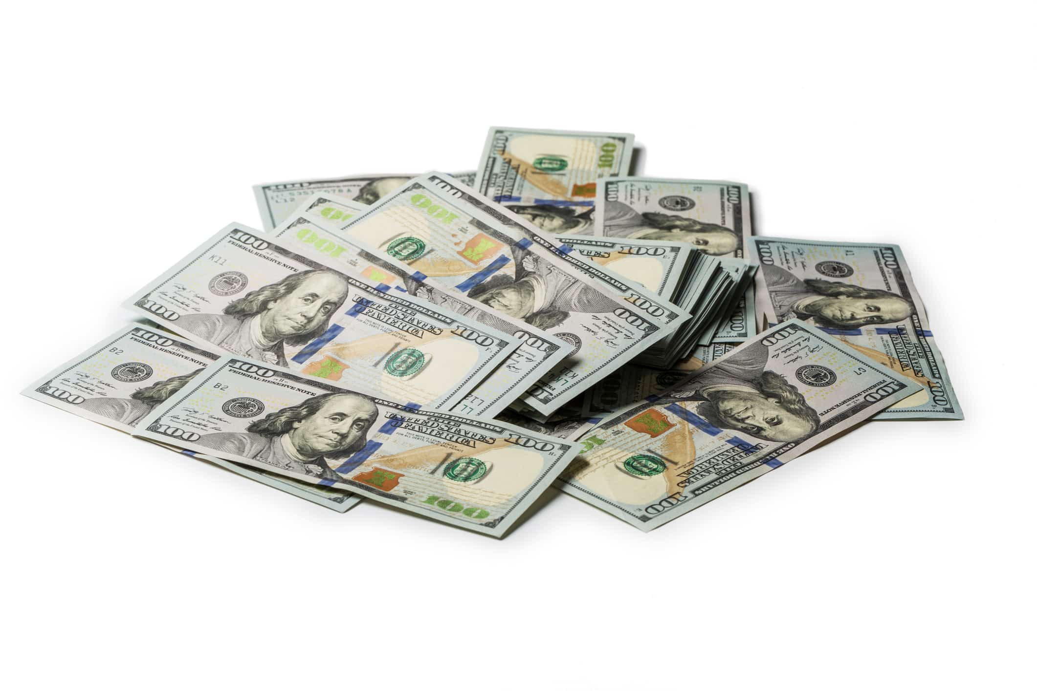 bundles of US 100 dollar bills
