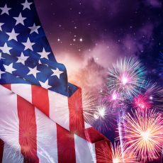 American flag and fireworks in a night sky