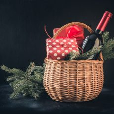 Holiday Basket with wine and wrapped gifts