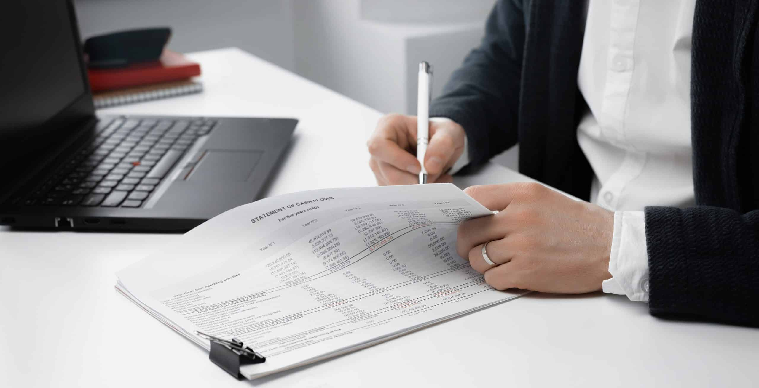 view of businessman signs a document or contract. Finance concept