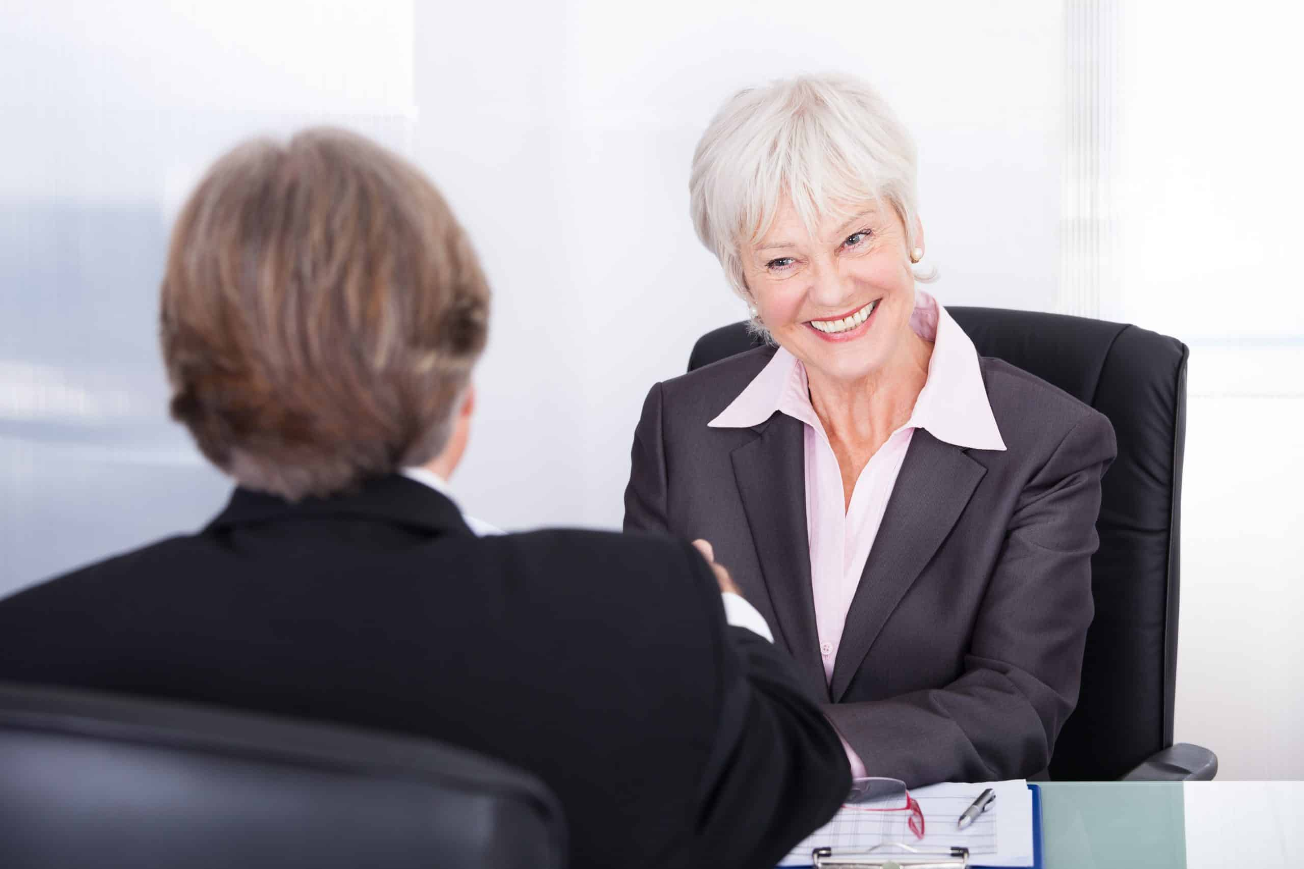 Mature Businesswoman And Businessman Discussing At Workplace